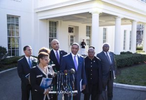 FILE -- Rep. Cedric Richmond (D-La.), third from right, chair of the Congressional Black Caucus, speaks to reporters after he and fellow members of the caucus had a meeting with President Donald Trump at the White House, in Washington, March 22, 2017. A change in how the Washington, D.C. police publicizes missing teenagers has led some observes to believe there were more cases. From left: Reps. Anthony Brown (D-Md.), Karen Bass (D-Calif.), Brenda Lawrence (D-Mich.), Andre Carson (D-Ind.), Richmond, Gwen Moore (D-Wis.) and James Clyburn (D-S.C.). (Doug Mills/The New York Times)