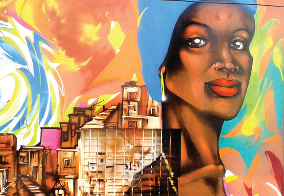 https://revistaraca.com.br/wp-content/uploads/2016/10/Grafite_no_Brs_retrata_a_mulher_negra.jpg